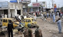 Pakistani security personnel are pictured at the site of a bomb attack in Badaber, near Peshawar